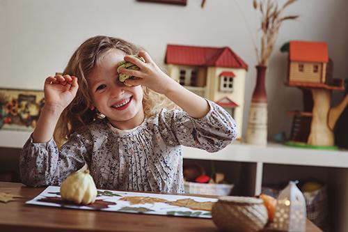 cute child girl making herbarium at home, autumn seasonal craftscute child girl making herbarium at home, autumn seasonal crafts
